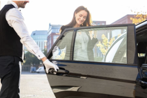 Valet opening the door for a woman